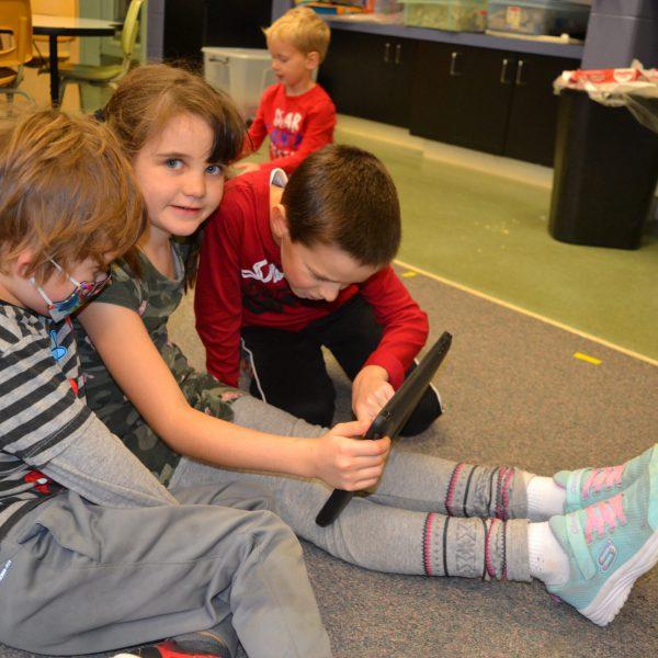 Students looking at notepad