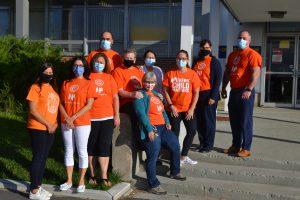 employees wearing orange